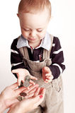 Little boy with coins Stock Images