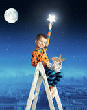 Little boy collecting shining stars Royalty Free Stock Photos