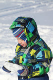 The little boy in a color jacket the piece of ice holding in hand Stock Photography