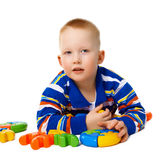 Little boy with color toys on white Royalty Free Stock Images