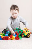 Little boy with colored cubes Stock Image