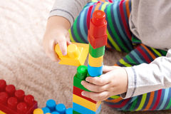 Little boy with colored cubes Stock Photography
