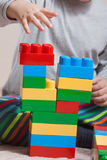 Little boy with colored cubes Royalty Free Stock Photo