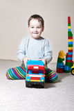 Little boy with colored cubes Royalty Free Stock Images