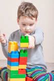 Little boy with colored cubes Royalty Free Stock Photography