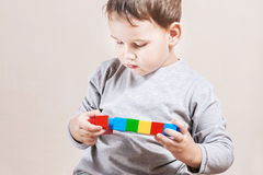 Little boy with colored cubes Stock Photo