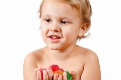Little boy with colored jelly candies Stock Photo