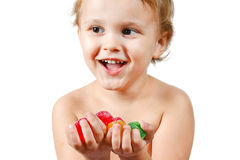 Little boy with colored jelly candies Royalty Free Stock Image