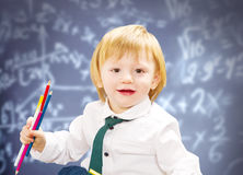 Little boy with colored pencil with blackboard Royalty Free Stock Photography