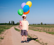 Little boy with colorful balloons Royalty Free Stock Photos