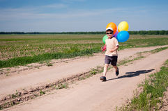 Little boy with colorful balloons Stock Photography