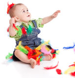 Little boy in colorful bright feathers Royalty Free Stock Photo
