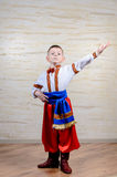 Little boy in colorful costume doing folk dancing Royalty Free Stock Photo