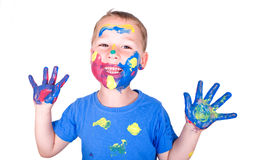 Little boy with colorful hands royalty free stock image