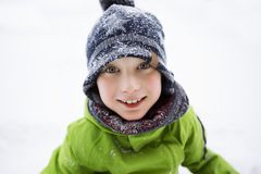 Closeup portrait of happy child in winter hat royalty free stock photography