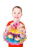 Little boy with colorful muffins Royalty Free Stock Photo