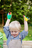 Little boy with colorful painted hands Stock Photography