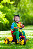 Little boy on colorful tricycle Royalty Free Stock Photography