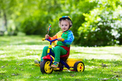 Little boy on colorful tricycle Royalty Free Stock Photos
