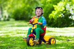 Little boy on colorful tricycle Stock Photography