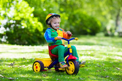 Little boy on colorful tricycle Royalty Free Stock Photo