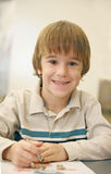 Little Boy Coloring. With a Big Smile on His Face Royalty Free Stock Images