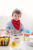 Little boy, coloring eggs for Easter Stock Image