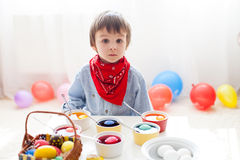 Little boy, coloring eggs for Easter Royalty Free Stock Images