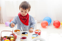 Little boy, coloring eggs for Easter Stock Photo