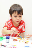 Little boy coloring water color close up Stock Photos
