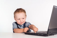 Little boy and computer Royalty Free Stock Photos