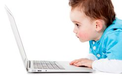 Little boy with a computer Royalty Free Stock Photography