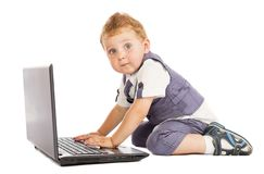 Little boy at the computer Royalty Free Stock Photography