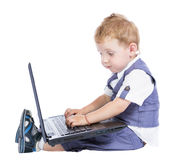 Little boy at the computer Royalty Free Stock Images