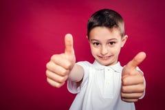Little Boy con los pulgares para arriba Imágenes de archivo libres de regalías