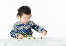 Little boy concentrate on drawing. Isolated on white Royalty Free Stock Photo