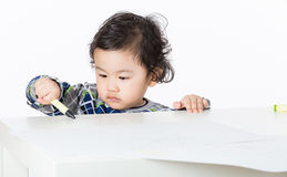 Little boy concentrate on drawing Stock Photo