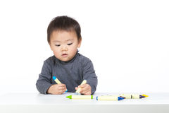 Little boy concentrate on drawing. And isolated on white Royalty Free Stock Photography