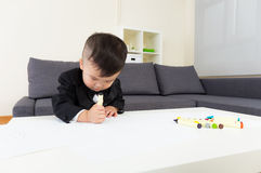 Little boy concentrate on drawing. At home Royalty Free Stock Image