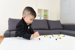 Little boy concentrate on drawing. At home Stock Image