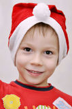 Little boy congratulates wears Santa's hat Stock Photo