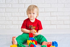 Little boy and constructor blocks. Kid playing with colorful constructor blocks Stock Photo