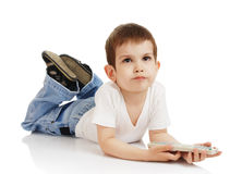 The little boy with the control panel from the TV Stock Photo