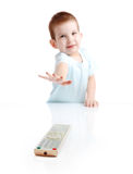 The little boy with the control panel from the TV Royalty Free Stock Images