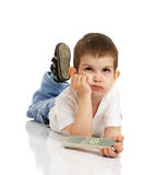 The little boy with the control panel from the TV Stock Photos