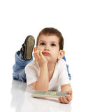 The little boy with the control panel from the TV Stock Image