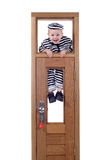 Little boy in convict clothes Stock Photo
