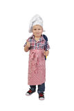 Little boy in cook chef hat and big spoon in hand Royalty Free Stock Images