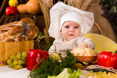Little boy in the cook costume Stock Photo