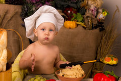 Little boy in the cook costume Stock Photography